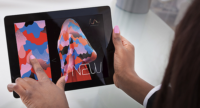 Cropped image of businesswoman's hands holding digital tablet at desk in office